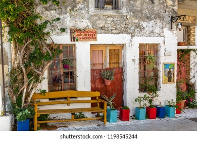 In the aisles of the mountain town of Archanes on the island of Crete, Greece (Text appeals to ecological behavior).