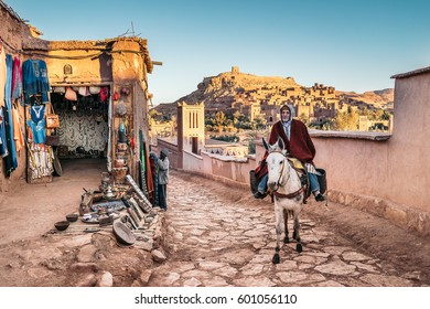AIT BEN HADDOU, MOROCCO - JANUARY 5, 2017: Man on a donkeyin the village of Ait Benhaddou. It is an fortified village in English along the former caravan route between the Sahara and Marrakech.