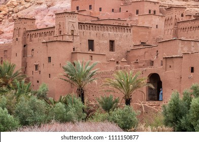Ait Ben Haddou, Morocco - march 23, 2012:View between palm trees of the walls and houses built with adobe, one of the best preserved kasbahs in the south of the country, declared a World Heritage Site