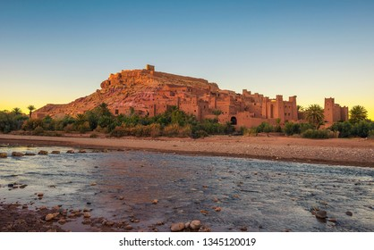Ait Benhaddou with Asif Ounila river in Morocco at sunset. This city was built along the caravan route between Sahara and Marrakech and is a popular filming location for many movies and TV series.