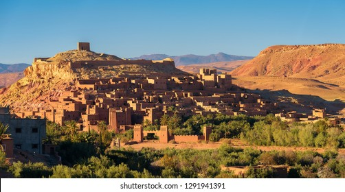 Ait Benhaddou in Morocco at sunset. This fortified city was built along the caravan route between Sahara and Marrakesh and is a popular filming location for many movies and TV series.