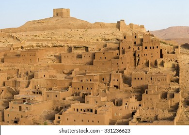 Ait-ben-Haddou is a fortified city, or ksar, along the former caravan route between the Sahara and Marrakech in present-day Morocco. Ait Benhaddou has been a UNESCO World Heritage Site since 1987.