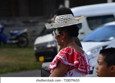 AITUTAKI, COOK ISLAND - AUGUST, 27 2017 - Local people at the christian mass wearing traditional colorful polynesian dress