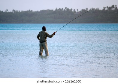 AITUTAKI - SEP 19:Fisherman casting for bonefish on Sep 19 2013.It's world's best place for fly fishing Bonefish that known for been the strongest and fastest moving fish of any salt water species.