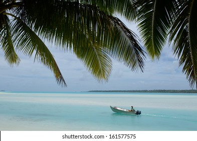 AITUTAKI - SEP 19:Fisherman in fishing boat on Sep 17 2013.It's world's best place for fishing Bonefish that known for been the strongest and fastest moving fish of any salt water species.