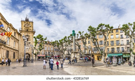 AIX EN PROVENCE, FRANCE - JULY 8, 2015: people enjoy sitting at the central place in Aix en  provence at town hall square. The townhall was built in the 17th century.