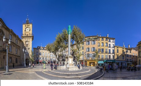 AIX EN PROVENCE, FRANCE - OCT 19, 2016: people visit the central market place with the famous hotel de ville in Aix en Provence, France.