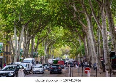 Aix En Provence, France - September 25, 2013: Avenue Paul Cezanne. Too many tourists walk and citizens likethis place