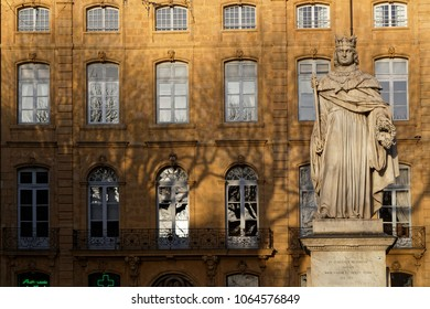 AIX-EN-PROVENCE, FRANCE, April 6, 2018 : At East end of Cours Mirabeau, raises a stone statue representing king Rene, died in Aix-en-Provence in 1480, holding a scepter and the bunch of grapes muscate