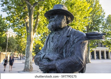 AIX-EN-PROVENCE, FRANCE - August 11, 2016: Statue of French artist and Post-Impressionist painter Paul Cezanne in Cours Mirabeau, a wide thoroughfare in Aix-en-Provence, France.