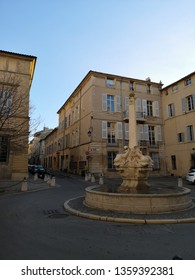 Aix-en-Provence, France - December 18, 2018: The fountain with four dolphin sculptures, the public square in the center of the Mazarin district in Aix-en-Provence.