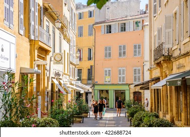 AIX-EN-PROVENCE, FRANCE - JUL 17, 2014: Beautiful shopping area in Aix-En-Provence with tourists walking betweens luxury shops on a warm summer day on Rue Nazareth
