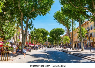 Aix-en-Provence, France - July 27, 2016: street Cours Mirabeau with unidentified people. 440 meters long and 42 meters wide, the Cours Mirabeau is one of the most popular and lively places in the town
