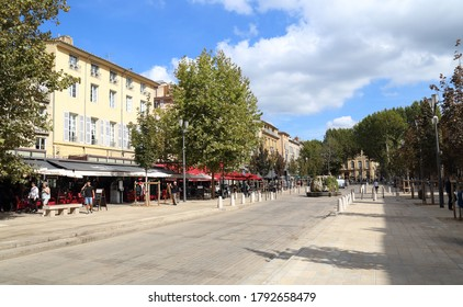 Aix-en-Provence, France - October 1, 2019: People walking on the Cours Mirabeau street lined with trees, cafes and restaurants in Aix-en-Provence, France on October 1, 2019