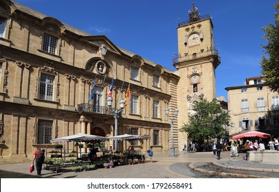 Aix-en-Provence, France - October 1, 2019: City hall and clock tower and people on the town square of Aix-en-Provence, France on October 1, 2019