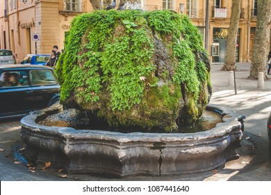 AIX-EN-PROVENCE, FRANCE - OCTOBER 9, 2009: Mossy Fountain or Fontaine d'Eau Chaude is hot water fountain built in 1668. Its water comes from thermal springs of the Bagniers