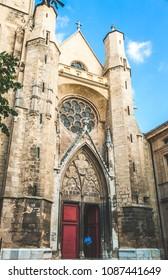 AIX-EN-PROVENCE, FRANCE - OCTOBER 9, 2009: Facade and entrance door of Saint-Jean de Malte Church, the first Gothic Roman Catholic church in Provence, built around 13th century