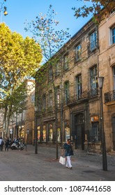 AIX-EN-PROVENCE, FRANCE - OCTOBER 9, 2009: Cours Mirabeau is 440 meter long street lined with plane trees, popular among both tourists and locals