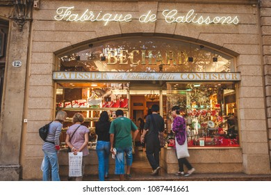 AIX-EN-PROVENCE, FRANCE - OCTOBER 9, 2009: People at famous family run patisserie Bechard which specializes in calissons, traditional French candy of Provence