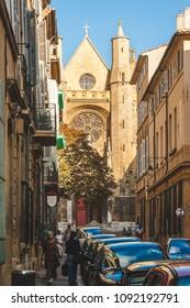 AIX-EN-PROVENCE, FRANCE - OCTOBER 9, 2009: Narrow street leading towards Saint-Jean de Malte Church, the first Gothic Roman Catholic church in Provence, built around 13th century
