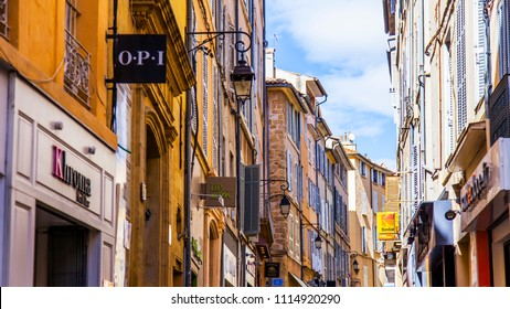 Aix-en-Provence, FRANCE, on March 6, 2018. Beautiful buildings form attractive skyline of the street in the downtown.