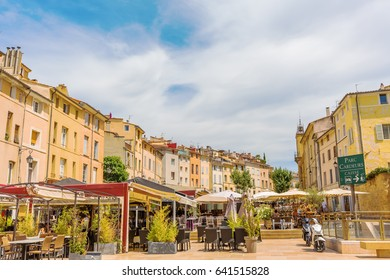 Aix-en-Provence - July 27, 2016: Place des Cardeurs with several cafes and unidentified people in Aix-en-Provence. Aix-en-Provence is University city and the historical capital of the Provence.
