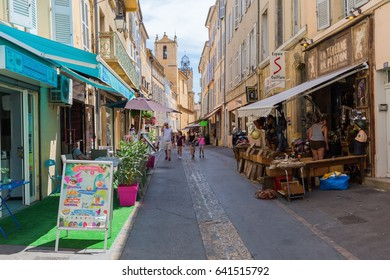 Aix-en-Provence - July 27, 2016: street in the old town of Aix-en-Provence, with unidentified people. Aix-en-Provence is University city and the historical capital of the Provence.