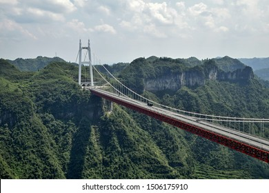 The Aizhai Bridge is a suspension bridge in Hunan province in China. The bridge was built as part of an expressway from southwest Chongqing to Changsha. Translation characters is: Aizhai big bridge.