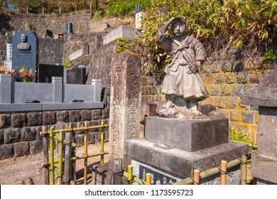 AIZUWAKAMATSU, JAPAN - APRIL 21 2018: Statue of young Byakkutai warrior observes the seige of Aizu-Wakamatsu Castle during the battle of Boshin war at the grave site of Byakkutai in  Mt. Iimori