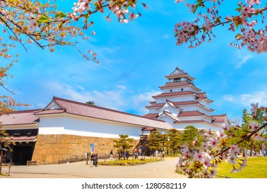 Aizuwakamatsu , Japan - April 21 2018: Aizu-Wakamatsu Castle and cherry blossom built by Ashina Naomori in 1384, Tenshu, the largest tower was reconstructed in 1965 in concrete