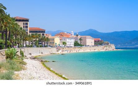 Ajaccio cityscape, Corsica island, France. Beach and old houses on a coastal street