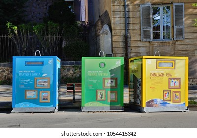 AJACCIO, CORSICA - APRIL 15 2016: Waste sorting junk pods are dyed variously with comments and signs. AJACCIO, CORSICA - APRIL 15 2016.