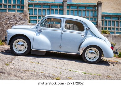 Ajaccio, France - July 6, 2015: Light blue Renault 4CV old-timer economy car stands parked on a roadside in French town, side view