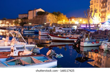 AJACCIO, FRANCE - MAY 2, 2013: The small fishing Port Tino Rossi with the old citadel on the background, on May 2, 2013 in Ajaccio, Corsica.