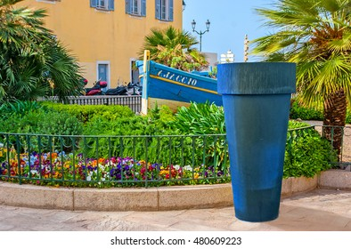 AJACCIO, FRANCE - MAY 2, 2013: The tiny garden with the flower bed and wooden boat, located next to Ajaccio Cathedral, on May 2 in Ajaccio.