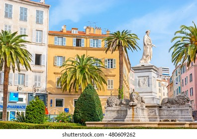 AJACCIO, FRANCE - MAY 2, 2013: The monument of Napoleon in Roman garb, surrounded by stone lions and ornamental garden, located in Place Foch, on May 2 in Ajaccio.