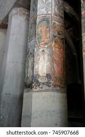 AJANTA, INDIA - OCT 4, 2017 - Ancient Buddhist fresco paintings on columns in Buddhist Cave 9, Ajanta, Maharashta, India