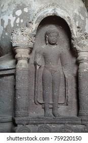 AJANTA, INDIA - OCT 4, 2017 - Carvings decorate columns in Buddhist Cave 19, Ajanta, Maharashta, India
