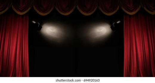 ajar red curtain on stage of the theater With spotlights, Gorgeous background with space for text for your message