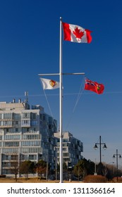 Ajax, Ontario, Canada - March 6, 2010: Canada Ontario and Ajax flags at Veterans Point Garden at sunset