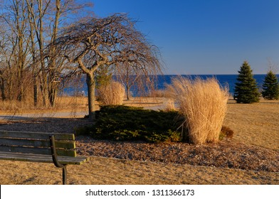 Ajax, Ontario, Canada - March 6, 2010: Barren winter landscape at Ajax Waterfront Park on Lake Ontario at sunset