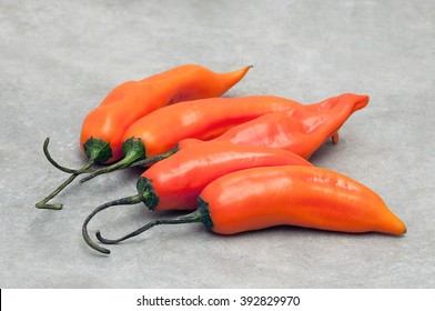 Aji Amarillo hot pepper on stone background