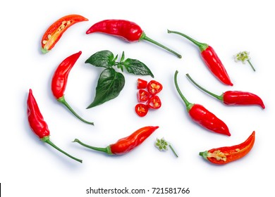 Aji Brazilian Bonanza pepper (C. baccatum), pods, diced, split, leaves, flowers. Clipping paths, shadows separated, top view