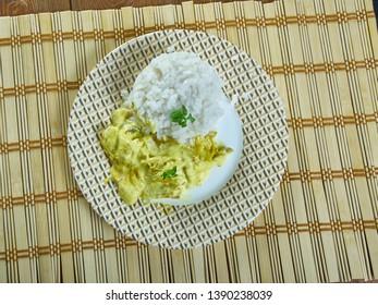 Aji  de gallina -  Peruvian chicken stewand aji amarillo peppers,served with boiled rice