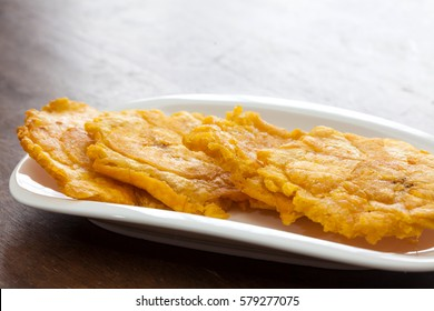 Ajiaco Preparation: Fried pieces of plantain called patacones