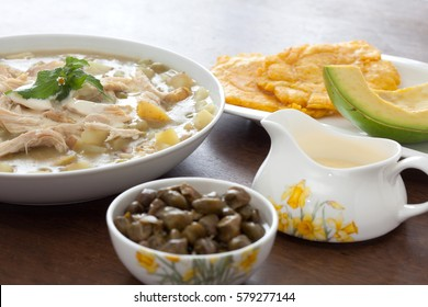 Ajiaco Preparation: Ajiaco served with patacon, avocado and capers