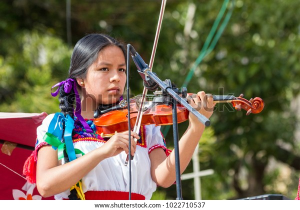 Ajijic, Jalisco / Mexico - december 10 2017: Violinist girl during a street event to entertain the tourist in the area