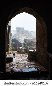 AJLOUN, JORDAN - FEBRUARY 18, 2012: patio of medieval Ajlun castle in rainy winter day. Ajloun Castle is Muslim castle, it was built in northwestern Jordan in 12th century