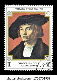 AJMAN - CIRCA 1971 : Cancelled postage stamp printed by Ajman state, that shows Painting Portrait of young man from 1521, circa 1971.