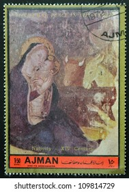 AJMAN - CIRCA 1972: A stamp printed in Ajman  Christmas collection, peace in the world,shows the Nativity of the XIV century painting, circa 1972